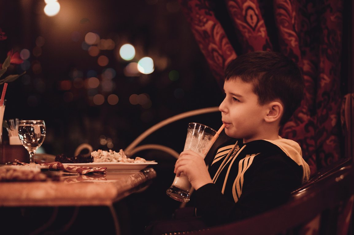 Boy drinking for free at a restaurant